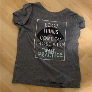 a gray t-shirt with a quote